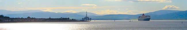 Panorama showing Cromarty, a rig and the QM2