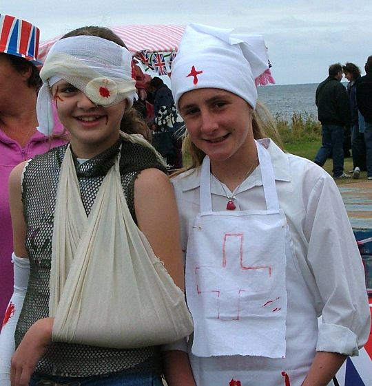 Corrie and Katie in fancy dress.