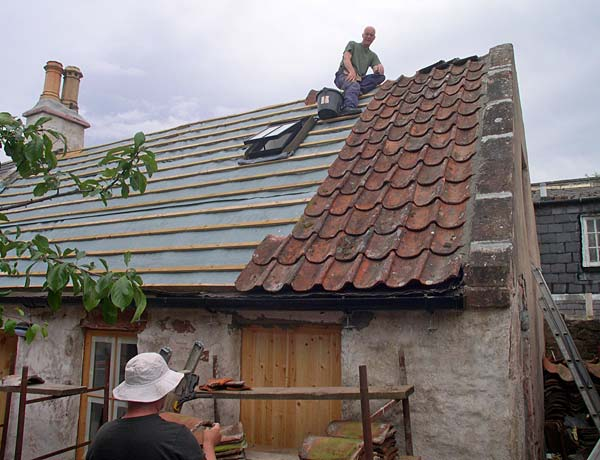 Pottery Workshop - pantiles going back on roof