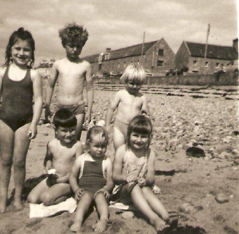 Johnston & Reid kids on the beach.