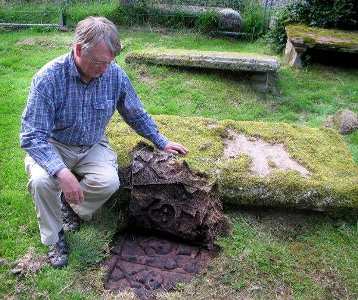 Revealing a gravestone at the East Church