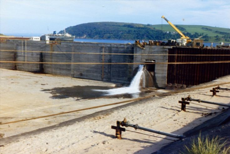 Sluices just opened, flooding the dock for the floatout of Highlahd Two 1974.