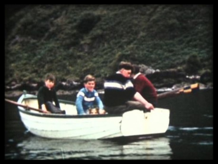 Lads in rowing boat