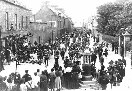 Military Procession in High St - c1910