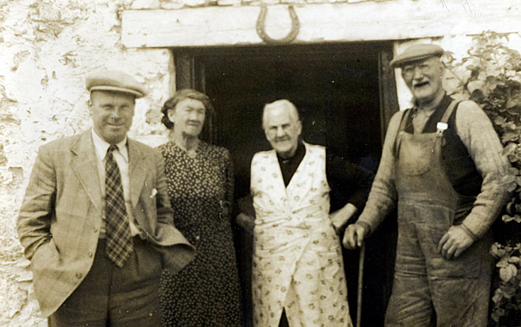 Unknown people in doorway at Rosefarm - c1950