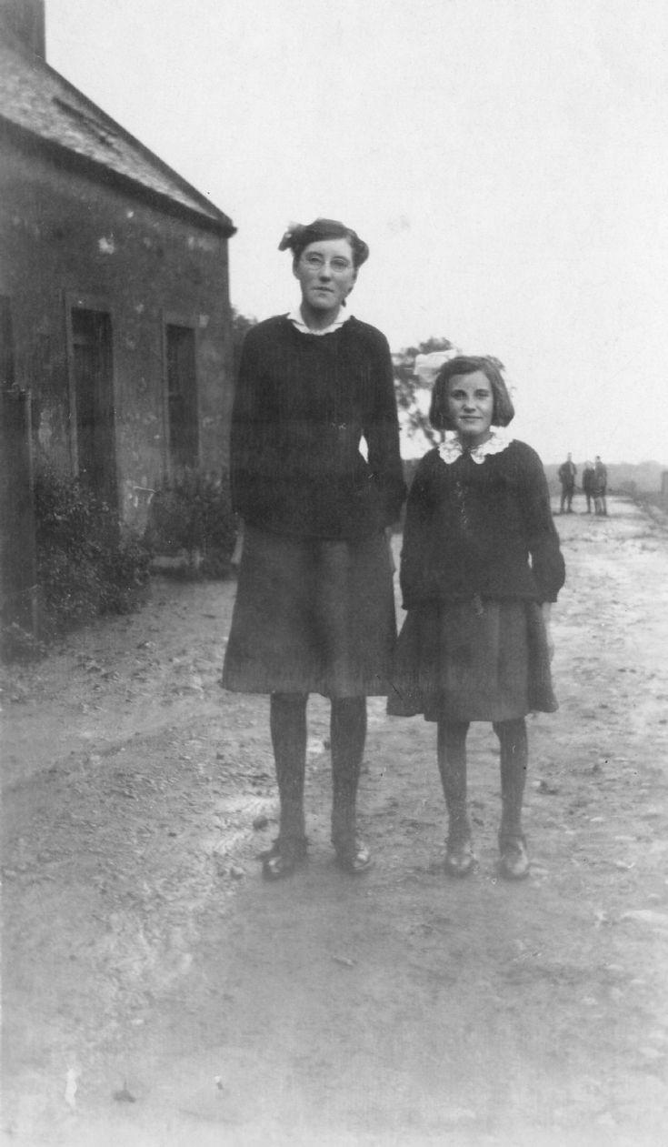 Williamina Sutherland outside Cromarty Mains Farm Cottages