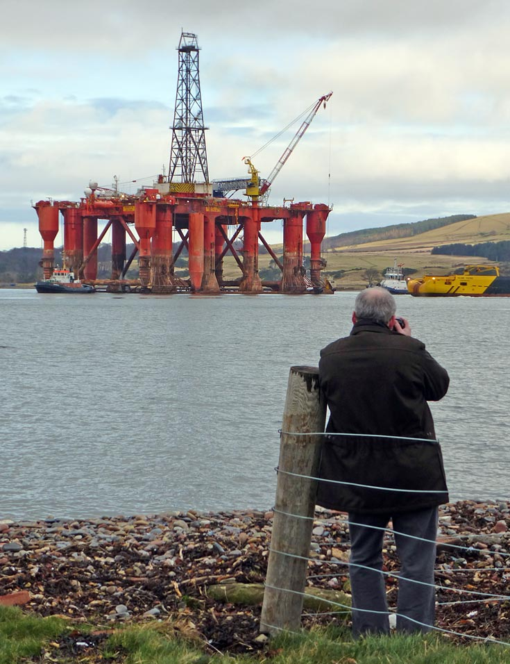 Calum Davidson taking photo of Borgsten Dolphin as it gets ready to leave the Cromarty Firth