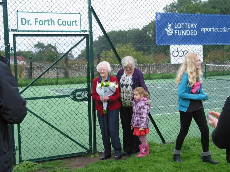 The official opening of the new tennis court on August 24th. Mrs Bain did the honours.