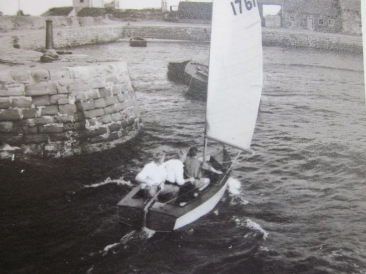 Dinghy in the harbour, c1960.