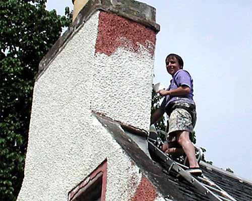 Gillian Newman painting her chimney