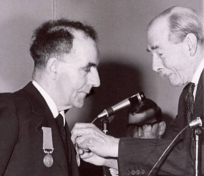 Albert Watson receiving medal - 1960
