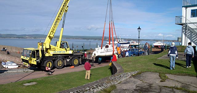 Yachts being lifted from Cromarty Harbour